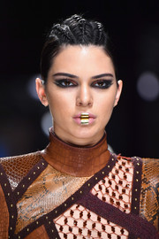 Kendall Jenner walked the Balmain runway wearing a ponytail with a cornrow top.
