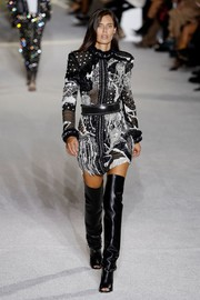Bianca Balti looked quite the rock star in this heavily embellished mini dress at the Balmain runway show.