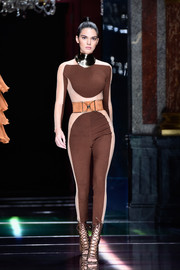Kendall struts the catwalk in a curve-hugging jumpsuit by Balmain.