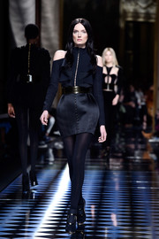 Lily Donaldson looked flirty in a black cold-shoulder ruffle blouse while walking the Balmain show.
