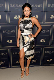Christina Milian joined the Balmain x H&M Los Angeles pre-launch wearing a leg-flaunting abstract-print dress.