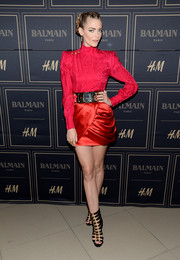 Jaime King kept the edgy-chic vibe going with a pair of black and gold gladiator heels by Balmain x H&M.