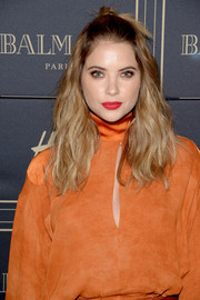 Ashley Benson styled her hair into a knotted half-up 'do with edgy waves for the Balmain x H&M Los Angeles pre-launch.