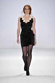 Barbara Meier modeled a NARCISS little black dress on the runway of the Baltic Fashion Catwalk Show.