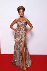 Sylvie van der Vaart arrived at the Bambi Awards in a glitzy beaded gown by Elie Saab with a sultry high slit.