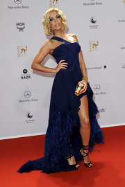 Sylvie van der Vaart was a feathered beauty at the Bambi Awards in a navy gown.