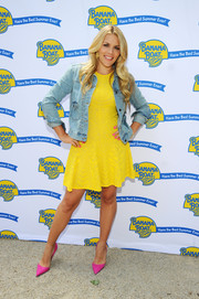 Busy Philipps styled a yellow skater dress with a faded denim jacket for the launch of the Best Summer Ever Sweepstakes.