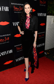 L'Wren Scott accentuated her slim figure with a black velvet pencil skirt from her own label.