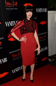 Jessica Pare attended the Banana Republic L'Wren Scott collection launch looking feminine in the designer's lip-print ruffle blouse.