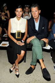 Giovanna Battaglia styled her outfit with an eye-catching oversized gold-buckled belt.