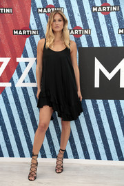 Bar Refaeli was boudoir-chic in a sleeveless LBD with an asymmetrical, ruffled hem during the Terrazza Martini inauguration in Barcelona.
