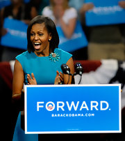 Michelle Obama accessorized her lovely turquoise dress with a bold flower brooch while helping to launch President Obama's re-election bid in Ohio.