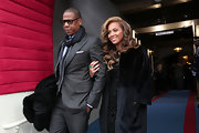 Beyonce bundled up for the inauguration festivities wearing this elegant black fur coat.