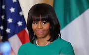 Michelle Obama wore a shoulder-length bob with blunt bangs during a White House reception.