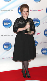 Adele donned a little black lace dress with a Peter Pan collar for the Barclaycard Mercury Prize.