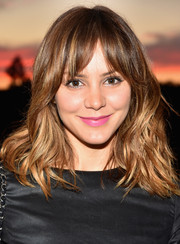 Katharine McPhee added a punch of color to her look with a bright pink lipstick.