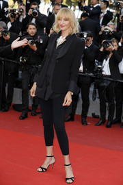 Uma Thurman gave her leggings a red carpet upgrade with a black tux jacket.