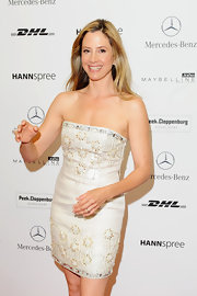 Mira Sorvino looked gorgeous in her beaded strapless dress at the Basler show.