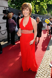 Birgit Schrowange was a sexy stunner in a beaded red halter gown.