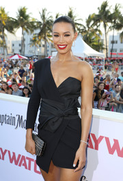 Ilfenesh Hadera accessorized with a beaded clutch for some sparkle to her LBD at the world premiere of 'Baywatch.'