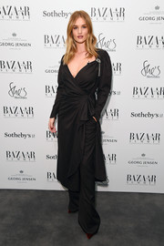 Rosie Huntington-Whiteley chose a low-cut pinstriped wrap dress by Attico for the Bazaar at Work Summit.