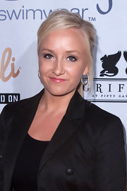 Nastia Liukin wore a pair of large hoop earrings at a swimwear fashion show.