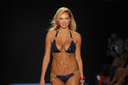 Kate Upton walks the runway at the Beach Bunny Swimwear show during Merecdes-Benz Fashion Week Swim 2012 at The Raleigh on July 15, 2011 in Miami Beach, Florida.