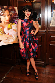 Hilaria Baldwin cut a lovely figure in a floral frock with a fitted bodice and a balloon skirt during her Beach magazine cover celebration.