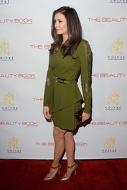 Nina Dobrev finished off her elegant look with gold ankle-strap pumps.