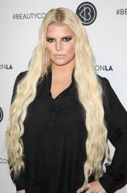 Jessica Simpson showed off long mermaid waves at the Beautycon Festival LA 2018.