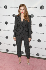 Holland Roden was office-chic in a charcoal suit at the Beautycon Festival LA 2018.