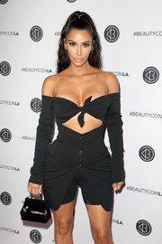 Kim Kardashian arrived for the Beautycon Festival LA 2018 carrying a mini patent purse by Dolce & Gabbana.
