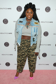 Danielle Brooks was edgy in camo pants and a distressed denim vest at Beautycon Festival NYC 2018.
