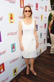 Jodie Foster looked demure in gold slingback peep-toes and a white cotton shift.