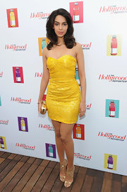 Mallika wore a sunshine yellow sequined cocktail dress to 'The Beaver' party at Cannes.