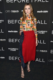 Zoey Deutch amped up the frill factor with a feather-embellished pencil skirt, also by Prada.