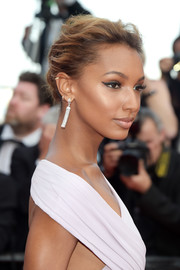 Jasmine Tookes topped off her look with a messy-elegant updo when she attended the Cannes Film Festival screening of 'The Beguiled.'