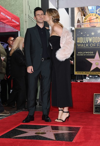 Behati Prinsloo Jumpsuit [adam levine honored with star on the hollywood walk of fame,red carpet,carpet,premiere,flooring,suit,event,dress,formal wear,tuxedo,adam levine,behati prinsloo,star,wife,mark ralston,kiss,california,l,afp]