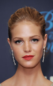 Erin Heatherton's red lipstick featured a slight orange undertone, which complemented her tanned skin beautifully!