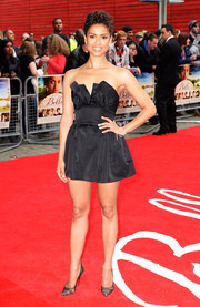 Gugu Mbatha-Raw went for a sexy, playful vibe in a strapless black romper by Martin Grant during the premiere of 'Belle.'