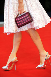 Isabelle Huppert finished off her ensemble at the 'Bella Addormentata' premiere with a woven leather purse.