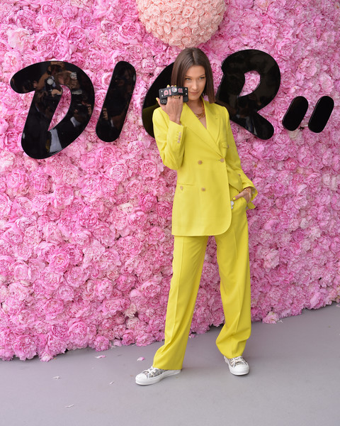 Bella Hadid Canvas Sneakers [pink,yellow,fun,magenta,pajamas,suit,smile,summer 2019,dior homme,bella hadid,spring,part,paris,france,photocall - paris fashion week,show,dior homme menswear spring]