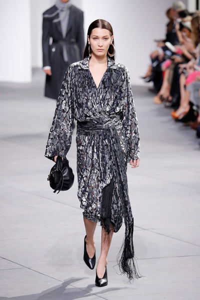 Bella Hadid Leather Clutch [michael kors collection fall 2017 runway show,fashion model,fashion,runway,fashion show,clothing,shoulder,outerwear,haute couture,dress,footwear,bella hadid,runway,new york city,michael kors collection,spring studios,fashion show]