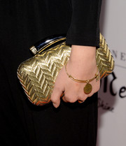 Lana Condor attended the Miss Me event wearing a cute gold charm bracelet.