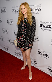 Bella Thorne toughened up her floral mini dress with a grommeted leather jacket for the Miss Me and Cosmopolitan spring campaign launch.