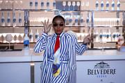 Janelle Monae teamed a nautical-print tie with a striped suit for the Belvedere Vodka 'Beautiful Future' limited edition bottle celebration in Chicago.