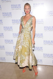 Carolyn Murphy looked stellar in this gold brocade dress at the Bergdorf Goodman anniversary celebration.