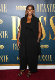 A sleeveless black coat provided a more polished finish to Queen Latifah's red carpet outfit.