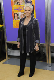 Judy Dench injects a bit of polish into a classic blazer by choosing a velvet finish.