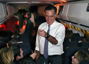 Mitt Romney chilled in a white button-down shirt with rolled-up sleeves while on board his campaign plane.